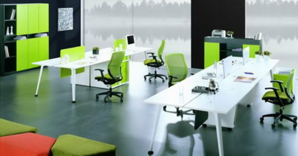 green office chairs and white office staff desks in modern office