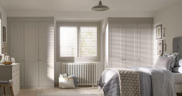 Fitted bedroom furniture is used to create an elegant but cosy
