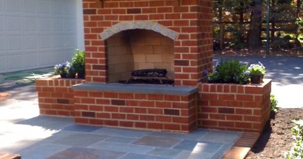 I love outdoor fireplaces. Cute idea to go with the pergola and