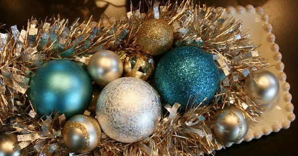 Silver Bells: Layer garland with a collection of colorful ornaments in your
