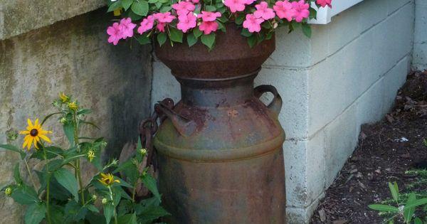 Milk can with cream separator as a planter gardening for Garden separator