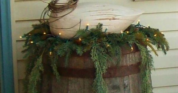Front porch Christmas decor with old barrel, wooden goose, greenery and white