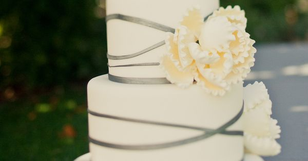 simple and elegant wedding cake. love this but with green ribbon and
