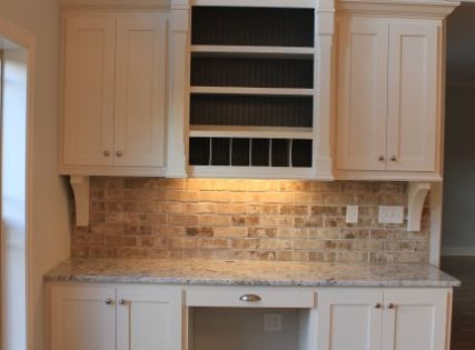 kitchen office space with faux brick backsplash & brackets
