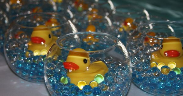 Baby shower idea- glass rose bowls, blue marbles, rubber duckies. Could use