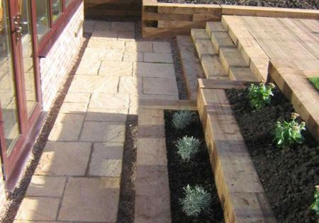 Retaining wall steps and decking from railway sleepers for Garden decking sleepers