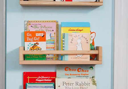 use Ikea spice racks for forward facing book shelves in the kids'