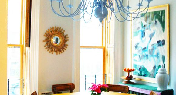 Spray painted old brass chandelier in bright color to go above dining