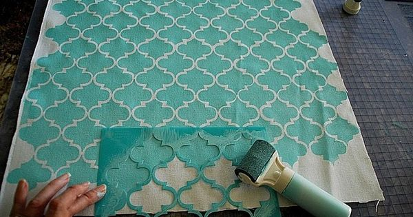 DIY stencil painted fabric - idea for backing on bookshelves