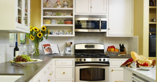Yellow kitchen walls with brown cabinets flower vase and for Yellow brown kitchen ideas