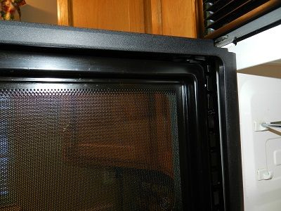 Cleaning Between The Mesh Screen And Glass Door On Your Microwave