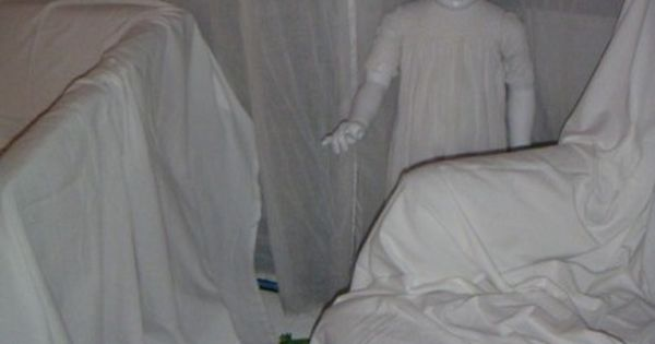 10 Terrifying DIY Props for Your Haunted House. Sheet covered furniture with