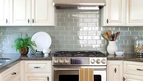 Glass tile backsplash, granite countertops, and upper cabinet glass door fronts -