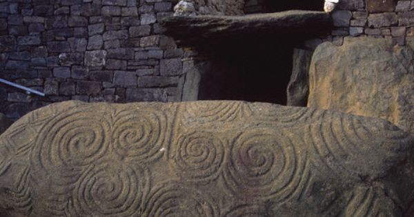 Large flat stones embellished with spiral carvings
