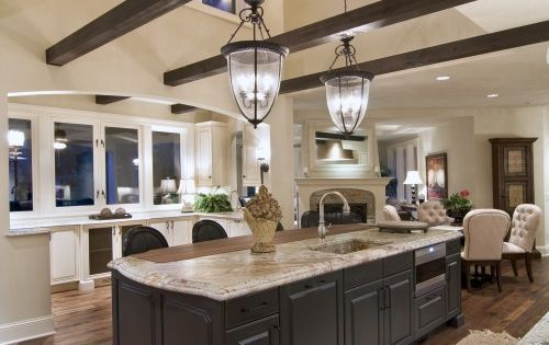 love the light fixtures and wood beams in this kitchen