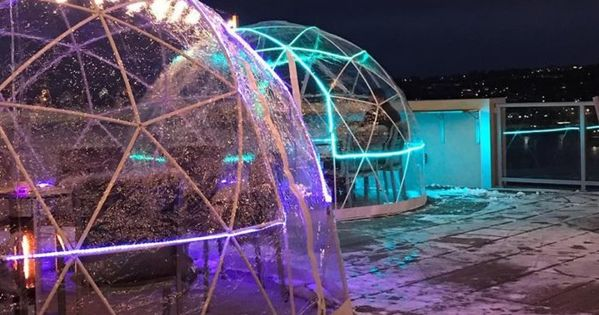 Stay Warm And Cozy This Season At Ac Hotel Cincinnati At The Banks A Rooftop Igloo Bar In Ohio Ac Hotel Rooftop Local Travel