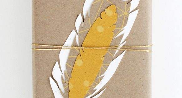 yellow feather gift tags with kraft paper - great wrapping idea