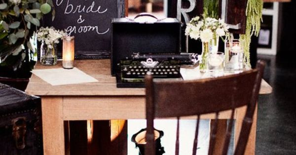 Welcome your guests with a vintage typewriter and a chalkboard. So cute.