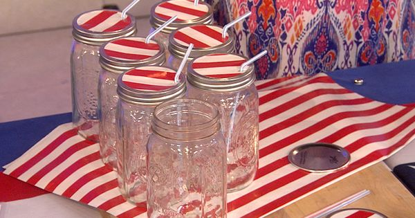 Mason jars can be covered with festive paper lids and straws... LOVE