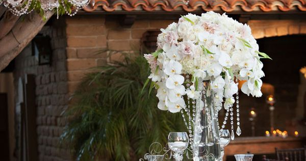 Chandeliers and floral centerpieces for wedding reception.