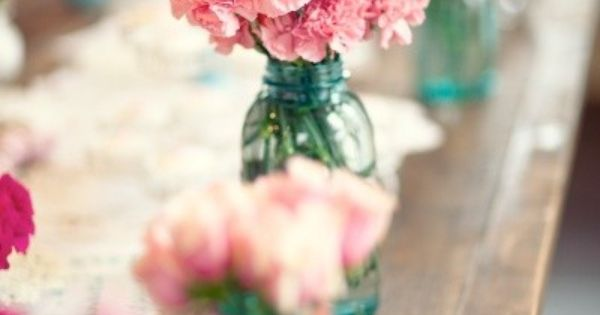 Love the color glass jars and pink flowers