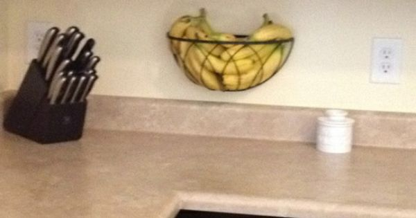 Hanging planter basket re-purposed as a fruit holder! Frees up valuable counter