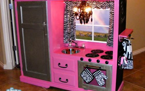Old tv stand turned into a little girls play kitchen! Sooo cute!