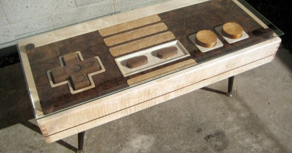 http://www.etsy.com/listing/96827992/nintendo-controller-coffee-table - per the desc on Etsy: Nintendo NES controller coffee table.