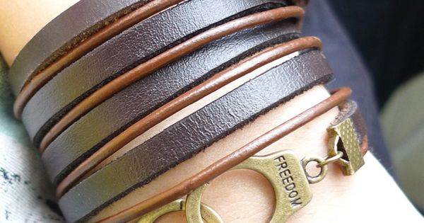 Brown leather wrap bracelet with copper handcuff buckle