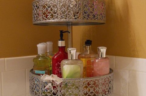 Use cake stands or tiered plant stands to declutter your bathroom counters. Cute idea!
