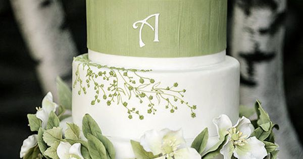 This white wedding cake with green floral designs is a beautiful choice