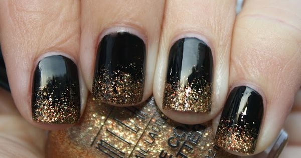 black and gold nails | Black nails with gold glitter gradient tips.