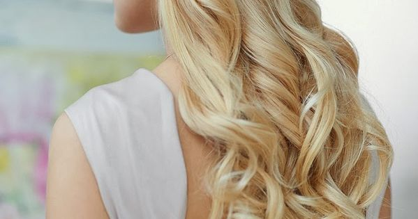 Brides hair style: a clip and a twist make this half up