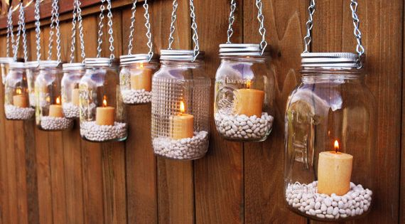 mason jars filled with beans hanging from fence