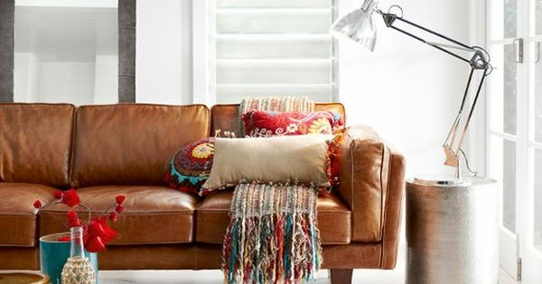 Caramel Leather Sofa And Industrial Furniture With Fun Rug
