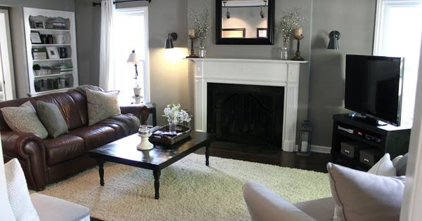 living room with gray walls, brown leather couch - the fat hydrangea.