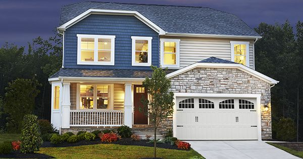 Elaborate Stonework An Inviting Covered Front Porch And