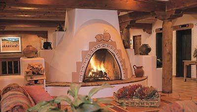 The Kiva Fireplace Steppin Up Out Southwest Style Fireplace Hotel Santa Fe Southwestern Fireplaces
