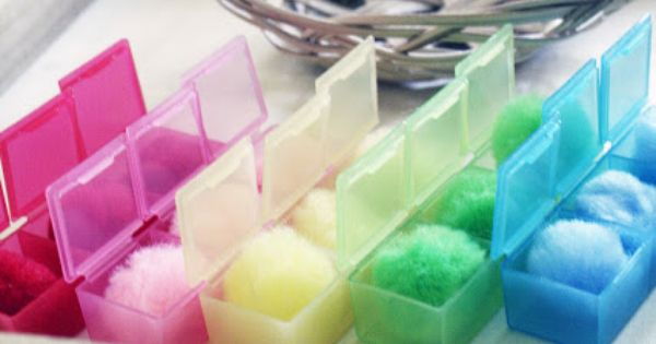 sorting pom poms into colored containers tot tray ideas