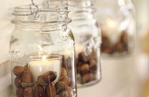Mason jars filled with acorns and glass votive candles, so pretty! falldecor
