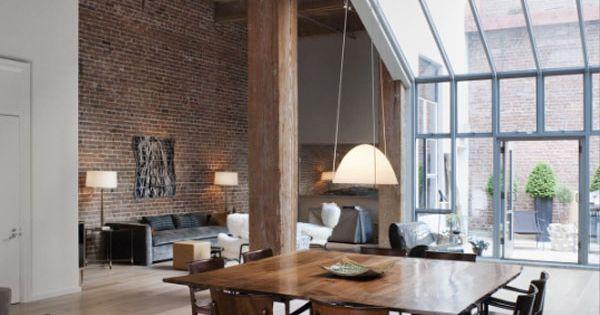 Open space, brick walls, wood beams & big windows