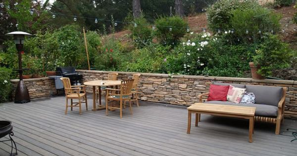 Three Level Trex Deck With A Stone Faced Retaining Wall