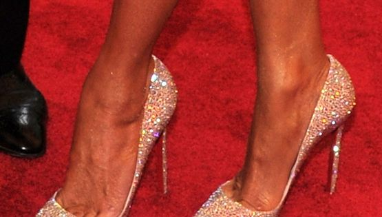 Crystal-encrusted pumps with the requisite red sole (by this designer) help this