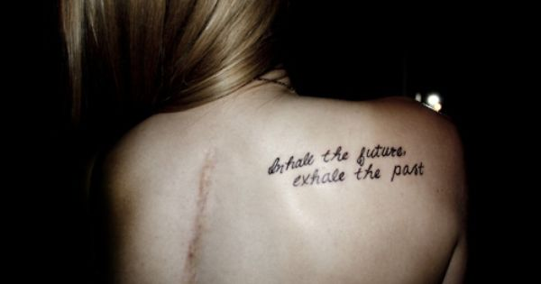 Shoulder Tattoo Quote: 'Inhale the Future, Exhale the past.'