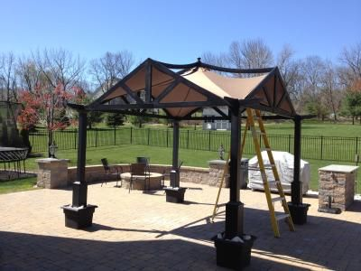 I Like How The Planters Were Used To Anchor The Gazebo And Add A
