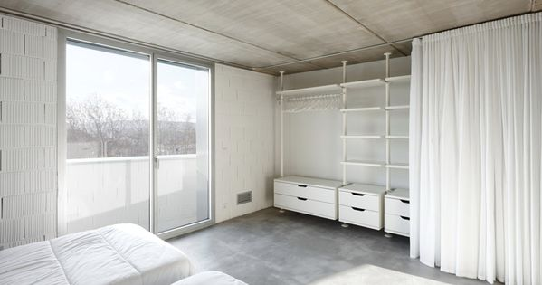 ikea stolmen open wardrobe system with white curtain cover grey polished concrete floor. Black Bedroom Furniture Sets. Home Design Ideas