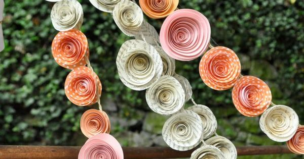 DIY paper rose streamers. Sweet.