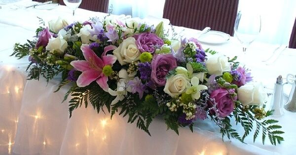 ceremony table flower arrangement of ivory Avalanch roses, dusky ...