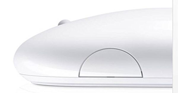Side view of Apples USB magic mouse.