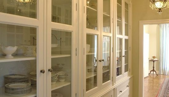 Butler's pantry storage. Cream cabinets. Glass front. To the ceiling!